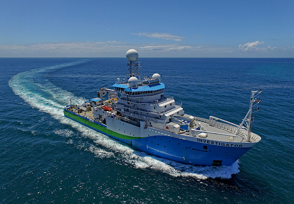 Investigator in open ocean. Photo credit: Owen Foley & MNF